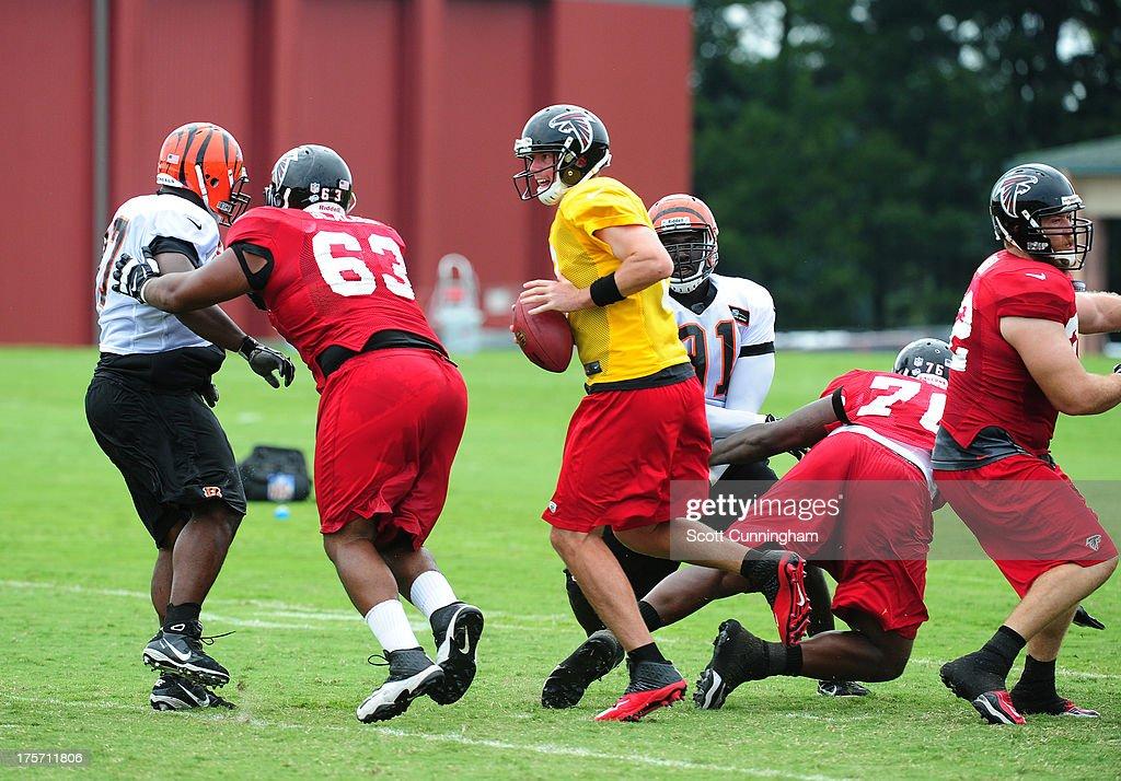 Matt Ryan #2 of the Atlanta Falcons passes against the Cincinnati Bengals during practice at the Atlanta Falcons Training Complex on August 6 2013 in Flowery Branch, Georgia.