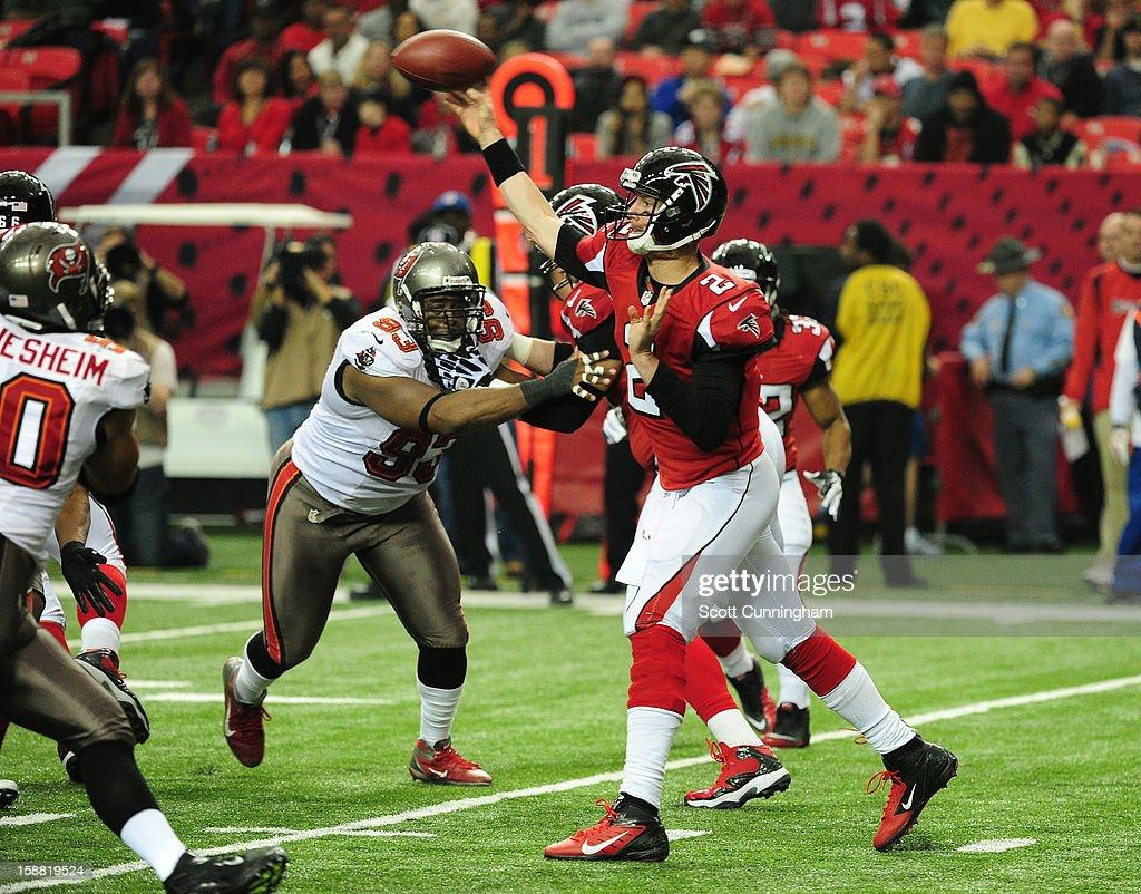 Matt Ryan #2 of the Atlanta Falcons passes against the Tampa Bay Buccaneers at the Georgia Dome on December 30, 2012 in Atlanta, Georgia