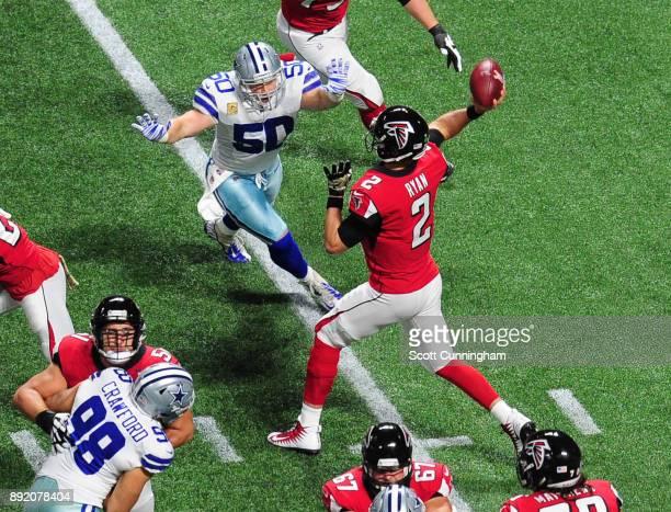 Matt Ryan of the Atlanta Falcons passes despite pressure by Sean Lee of the Dallas Cowboys at Mercedes-Benz Stadium on November 12, 2017 in Atlanta,...