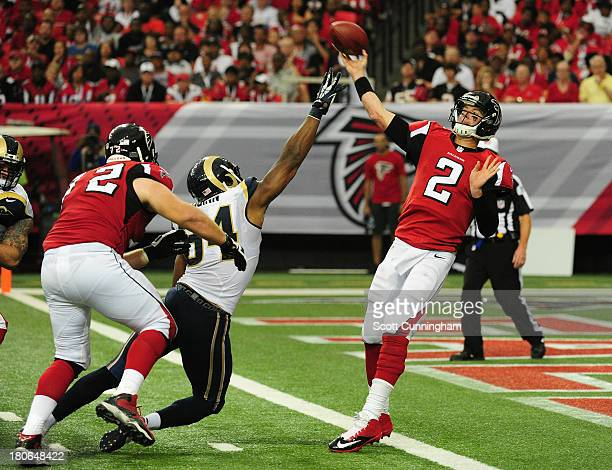 Matt Ryan of the Atlanta Falcons passes despite pressure fom Robert Quinn of the St. Louis Rams at the Georgia Dome on September 15, 2013 in Atlanta,...