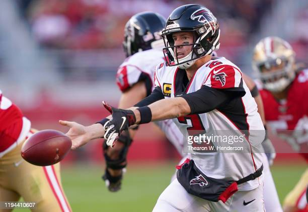 Matt Ryan of the Atlanta Falcons pitches the ball to a running back against the San Francisco 49ers during the second half of an NFL football game at...