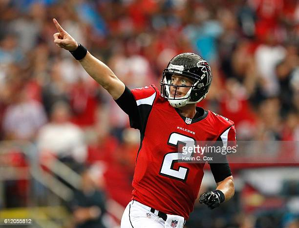 Matt Ryan of the Atlanta Falcons reacts after passing for a touchdown to Aldrick Robinson against the Carolina Panthers at Georgia Dome on October 2...