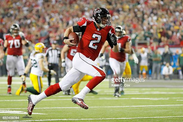 Matt Ryan of the Atlanta Falcons runs for a 14 yard touchdown in the second quarter against the Green Bay Packers in the NFC Championship Game at the...
