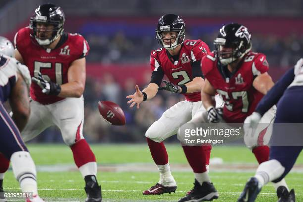 Matt Ryan of the Atlanta Falcons runs the play against the New England Patriots during the fourth quarter during Super Bowl 51 at NRG Stadium on...