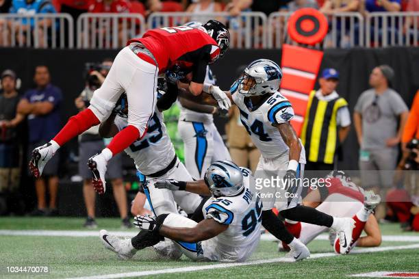 Matt Ryan of the Atlanta Falcons scores a rushing touchdown during the second half against the Carolina Panthers at Mercedes-Benz Stadium on...