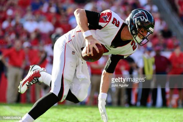 Matt Ryan of the Atlanta Falcons scrambles before throwing an interception during the fourth quarter against the Tampa Bay Buccaneers at Raymond...