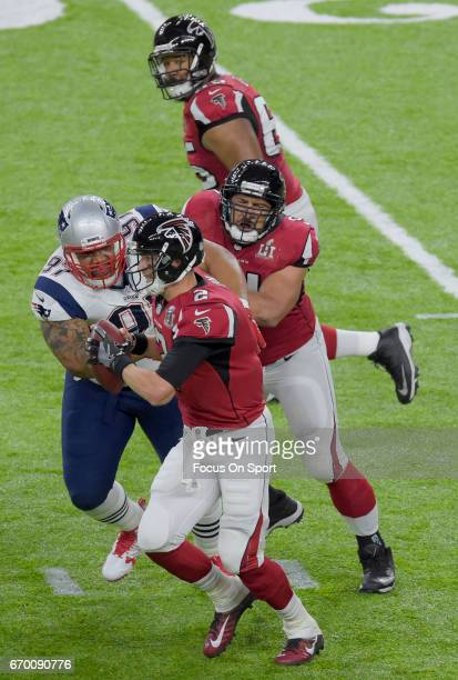 Matt Ryan of the Atlanta Falcons scrambles from the pressure of Alan Branch of the New England Patriots during Super Bowl 51 at NRG Stadium on...