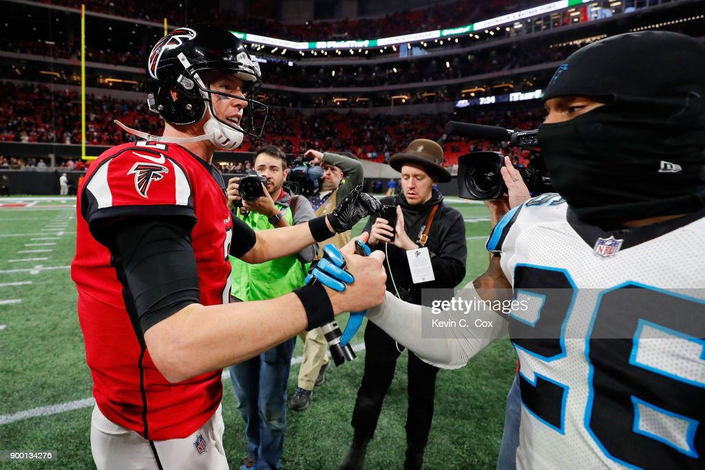 Matt Ryan #2 of the Atlanta Falcons shakes hands with Daryl Worley #26 of the Carolina Panthers after the game at Mercedes-Benz Stadium on December 31, 2017 in Atlanta, Georgia.