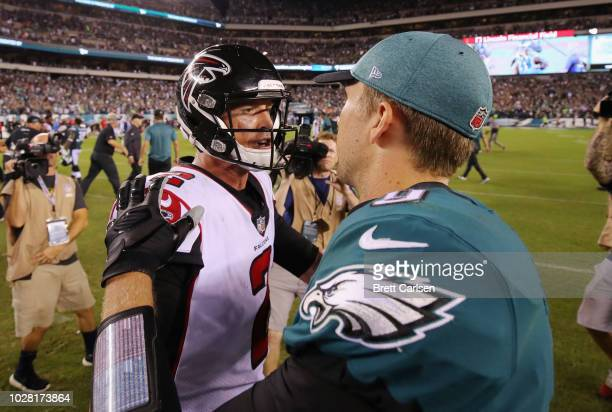 Matt Ryan of the Atlanta Falcons shakes hands with Nick Foles of the Philadelphia Eagles after the Eagles defeated the Falcons 1812 at Lincoln...