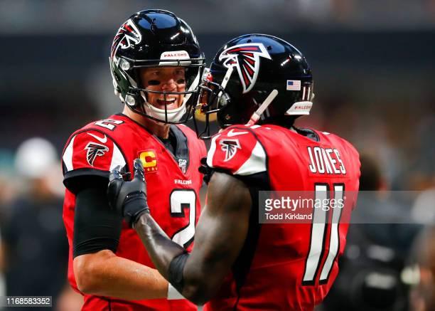Matt Ryan of the Atlanta Falcons speaks with Julio Jones prior to an NFL game against the Philadelphia Eagles at MercedesBenz Stadium on September 15...