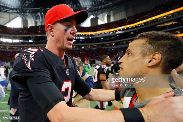 Matt Ryan of the Atlanta Falcons talks to Brent Grimes of the Tampa Bay Buccaneers after the game at MercedesBenz Stadium on November 26 2017 in...
