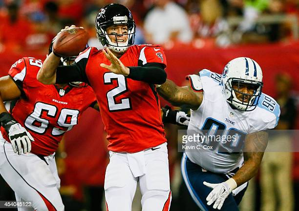 Matt Ryan of the Atlanta Falcons throws a pass under pressure from Jurrell Casey of the Tennessee Titans in the second half of a preseason game at...