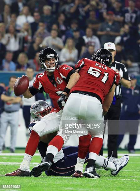 Matt Ryan of the Atlanta Falcons throws under pressure against the New England Patriots in the fourth quarter during Super Bowl 51 at NRG Stadium on...
