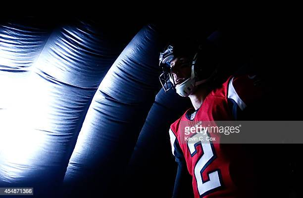 Matt Ryan of the Atlanta Falcons waits for pregame introductions prior to facing the New Orleans Saints at Georgia Dome on September 7 2014 in...