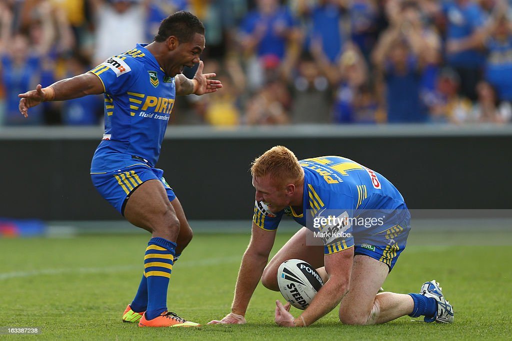 Matt Ryan of the Eels is congratulated by Chris Sandow of the Eels as he celebrates scoring a try during the round one NRL match between the Parramatta Eels and the Warriors at Parramatta Stadium on March 9, 2013 in Sydney, Australia.
