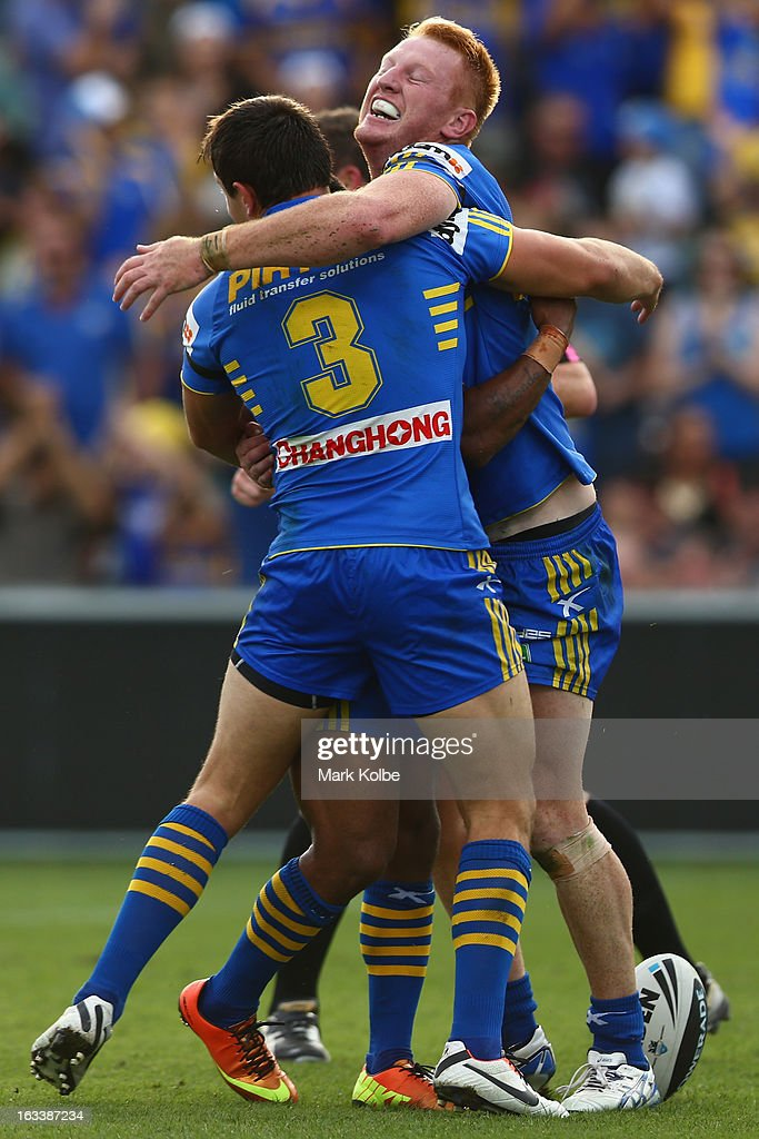 Matt Ryan of the Eels is congratulated by his team mates as he celebrates scoring a try during the round one NRL match between the Parramatta Eels and the Warriors at Parramatta Stadium on March 9, 2013 in Sydney, Australia.