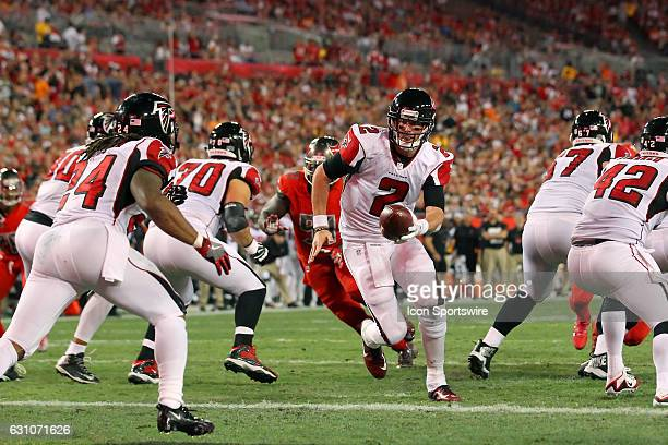 Matt Ryan of the Falcons turns to hand the ball off during the NFL game between the NFC South opponent Atlanta Falcons and Tampa Bay Buccaneers on...