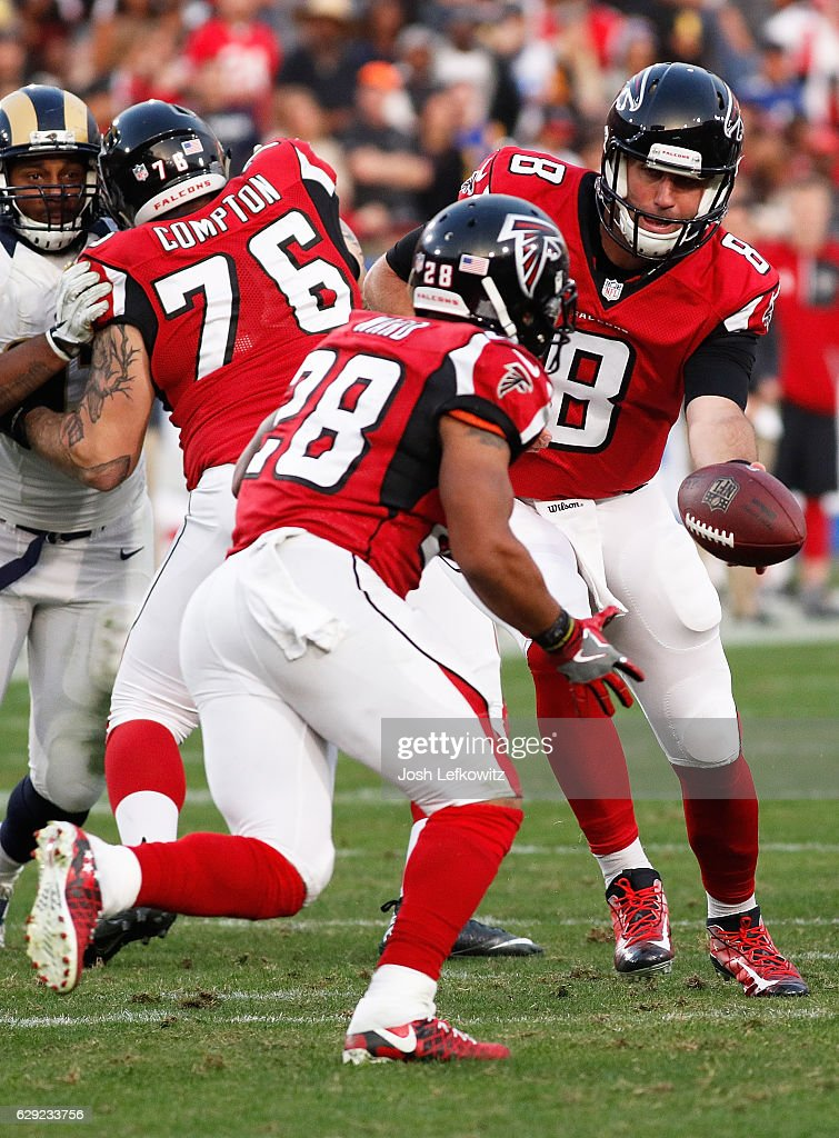 Matt Schaub #8 of the Atlanta Falcons hands off the ball to Terron Ward #28 against the Los Angeles Rams at the Los Angeles Memorial Coliseum on December 11, 2016 in Los Angeles, California.