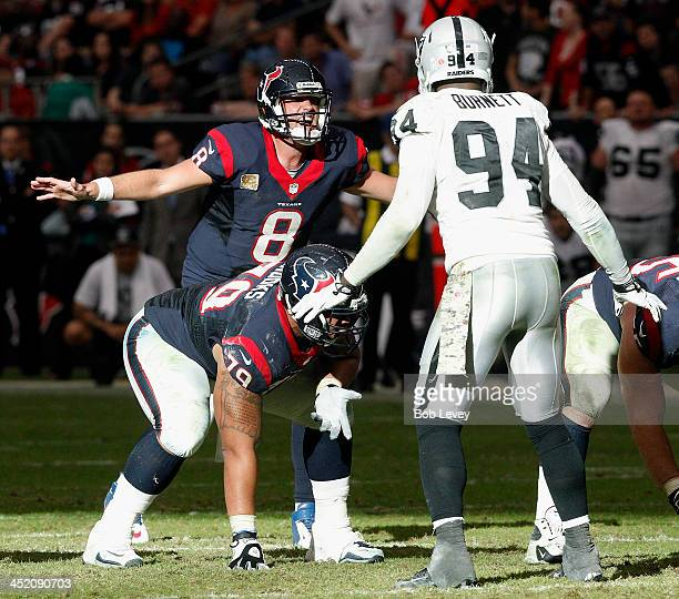 Matt Schaub of the Houston Texans calls out the play from the line of scrimmage as he awaits the snap from center Chris Myers and Kevin Burnett of...