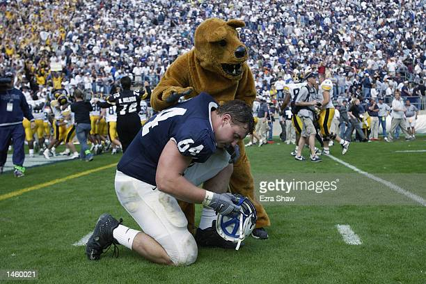 Matt Schmitt of the Penn State gets a tap on the back from the Nittany Lion after Penn State lost to Iowa on September 28 2002 at Beaver Stadium in...