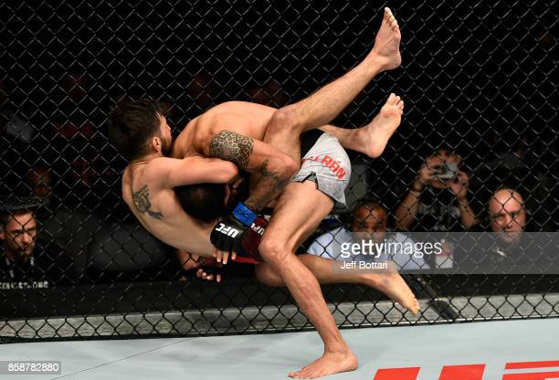 Matt Schnell attempts to secure a guillotine choke submission against Marco Beltran of Mexico in their flyweight bout during the UFC 216 event inside...