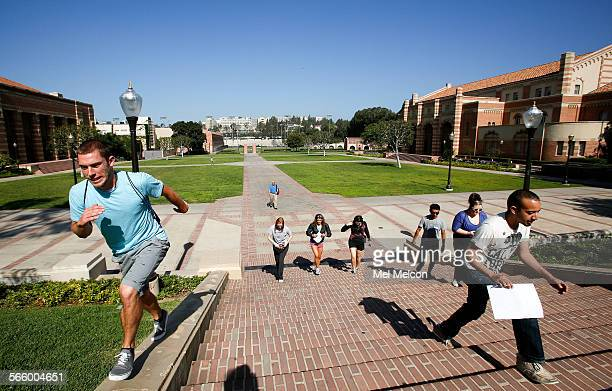 Matt Scholer left a summer camp counselor makes his way up the stairs with other counselors on the UCLA campus in Westwood on June 20 2013