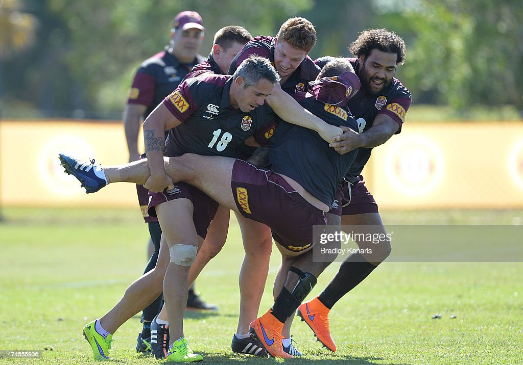 Matt Scott is tackled by Sam Thaiday and Corey Parker during the Queensland Maroons State of Origin training session at Sanctuary Cove on May 24, 2015 in Brisbane, Australia.