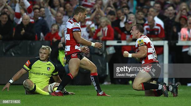 Matt Scott of Gloucester celebrates after scoring the first try during the Aviva Premiership match between Gloucester and Leicester Tigers at...