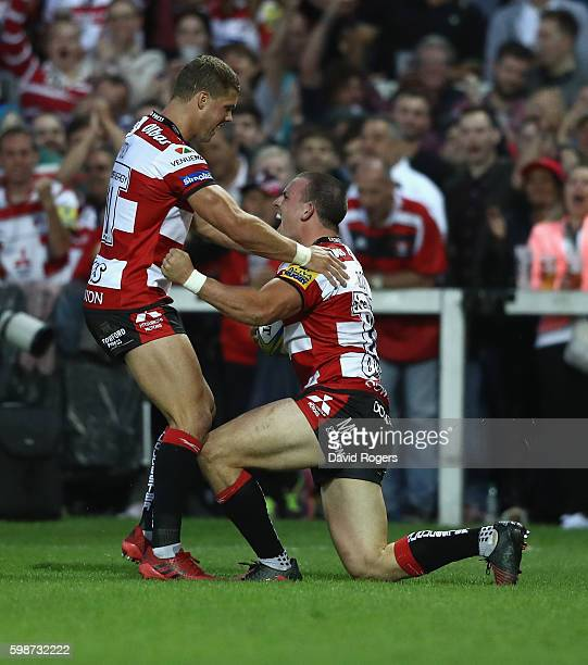 Matt Scott of Gloucester celebrates with team mate Henry Purdy after scoring the first try during the Aviva Premiership match between Gloucester and...