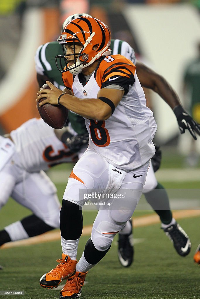 Matt Scott #8 of the Cincinnati Bengals drops back to pass during the game against the New York Jets at Paul Brown Stadium on August 16, 2014 in Cincinnati, Ohio. The Jets defeated the Bengals 25-17.