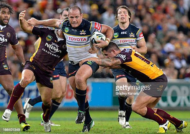 Matt Scott of the Cowboys breaks through the defence during the round six NRL match between the Brisbane Broncos and the North Queensland Cowboys at...