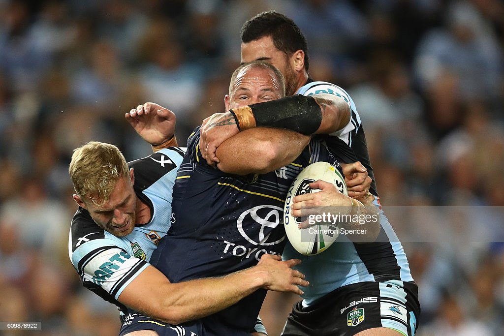 Matt Scott of the Cowboys is tackled during the NRL Preliminary Final match between the Cronulla Sharks and the North Queensland Cowboys at Allianz Stadium on September 23, 2016 in Sydney, Australia.