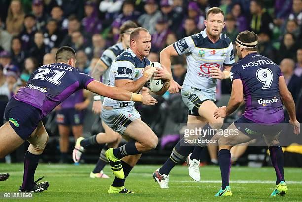 Matt Scott of the Cowboys is tackled during the NRL Qualifying Final match between the Melbourne Storm and the North Queensland Cowboys at AAMI Park...