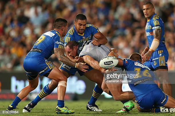 Matt Scott of the Cowboys is tackled during the round two NRL match between the Parramatta Eels and the North Queensland Cowboys at Pirtek Stadium on...