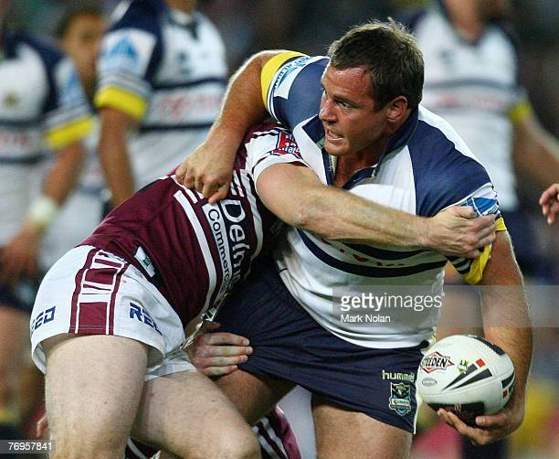 Matt Scott of the Cowboys looks to offload during the first preliminary final NRL match between the ManlyWarringah Sea Eagles and the North...