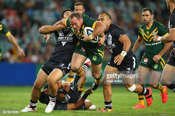Matt Scott of the Kangaroos is tackled during the ANZAC Test match between the Australian Kangaroos and the New Zealand Kiwis at Allianz Stadium on...