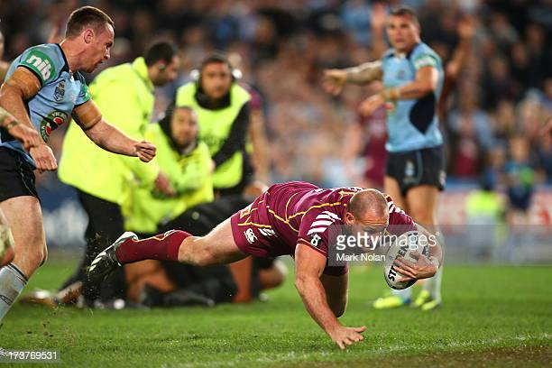 Matt Scott of the Maroons scores a disallowed try during game three of the ARL State of Origin series between the New South Wales Blues and the...