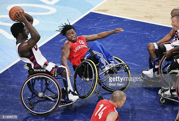 Matt Scott of the USA steals the ball from Ade Adepitan of Great Britain in the quarterfinals of Wheelchair Basketball on September 25 2004 during...