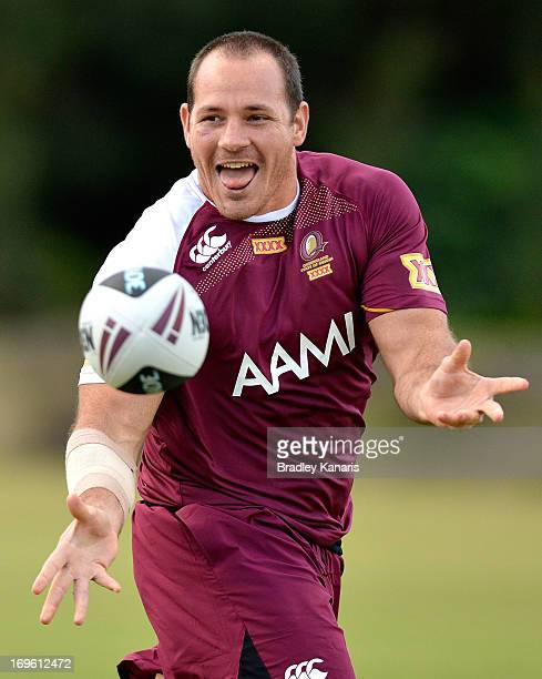 Matt Scott passes the ball during a Queensland Maroons State of Origin training session at Palmer Resort Coolum on May 29 2013 in Brisbane Australia