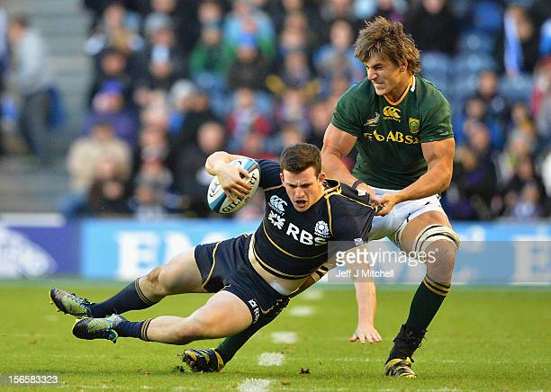 Matt Scott Scotland is tackled by Eben Etzebeth of South Africa during the international match between Scotland and South Africa at Murrayfield...