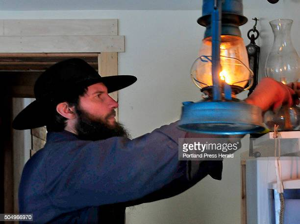 Matt Secich lights oil lamps at his Charcuterie shop in Unity on Wednesday January 13 2016