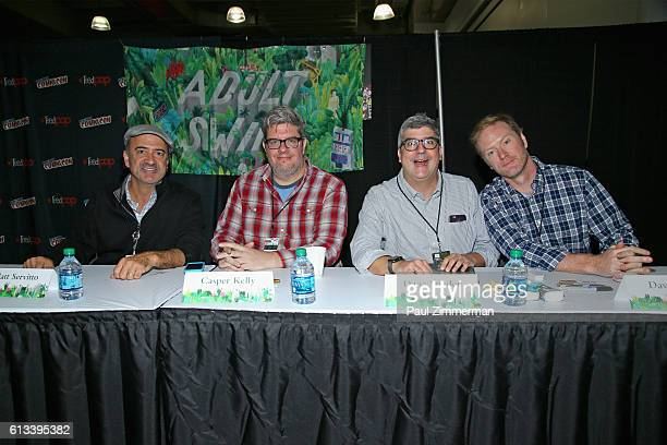 Matt Servitto Casper Kelly Dana Snyder and Dave Willis of Your Pretty Face Is Going to Hell signs autographs for fans during the Adult Swim signing...