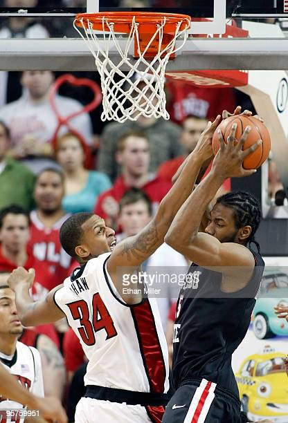 Matt Shaw of the UNLV Rebels and Kawhi Leonard of the San Diego State Aztecs fight for a rebound during their game at the Thomas Mack Center January...