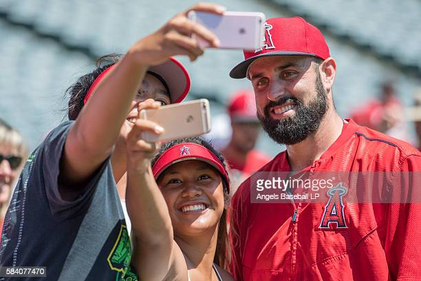 Matt Shoemaker of the Los Angeles Angels of Anaheim poses for selfies with fans during season seat holder photo day before the game against the...