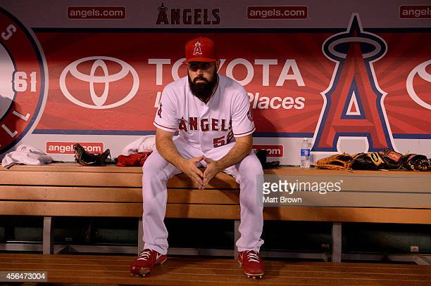 Matt Shoemaker of the Los Angeles Angels of Anaheim sits in the dugout before the game against the Seattle Mariners on September 15 2014 at Angel...