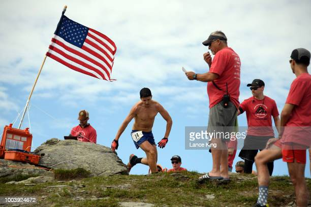 Matt Shryock passes the top of Mount Marathon during the Men's Division of the 91st Running of the Mount Marathon Race on July 4 2018 in Seward...