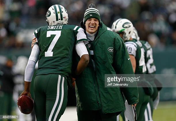 Matt Simms greets Geno Smith of the New York Jets after his touchdown against the Oakland Raiders during their game at MetLife Stadium on December 8...