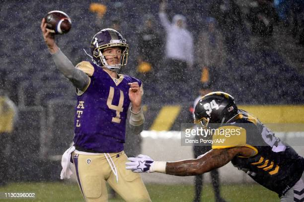Matt Simms of the Atlanta Legends throws a pass while being pressured by Damontre Moore of the San Diego Fleet in the second quarter during the...