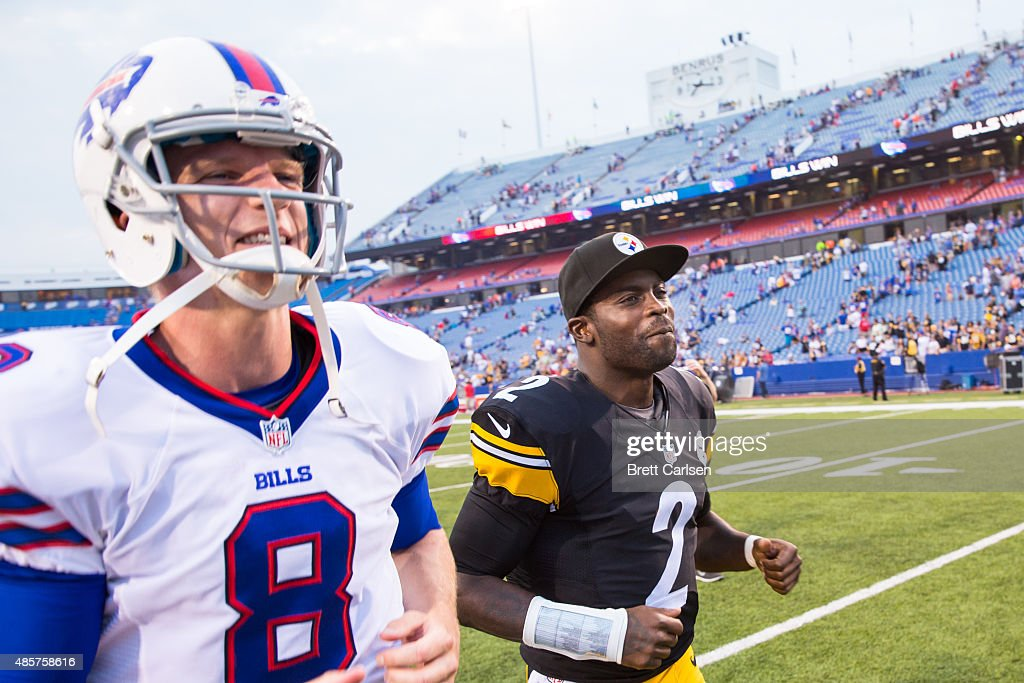 Matt Simms #8 of the Buffalo Bills and Michael Vick #2 of the Pittsburgh Steelers run off the field after a preseason game on August 29, 2015 at Ralph Wilson Stadium in Orchard Park, New York. Buffalo defeats Pittsburgh 43-19.