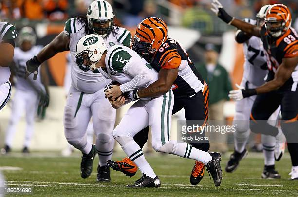 Matt Simms of the New York Jets is sacked by James Harrison of the Cincinnati Bengals during the game at Paul Brown Stadium on October 27 2013 in...